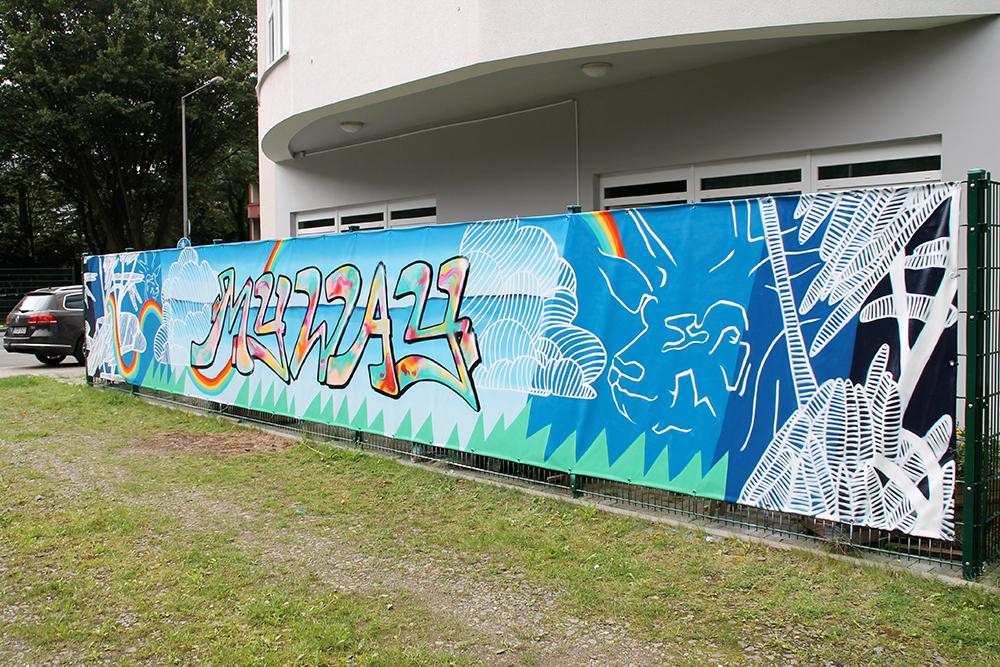 Graffitigestaltung von Sichtschutzbanner