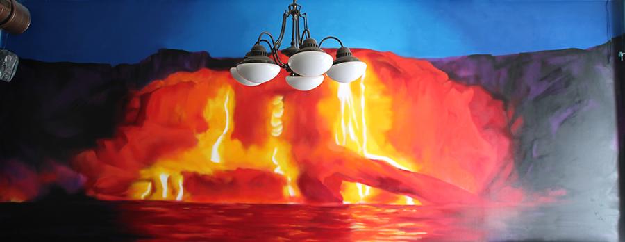 Graffiti-Gestaltung in Berlin-Friedrichhain. In Rottönen gehaltenes Vulkanbild mit Lava.